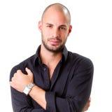 Stylish young man wearing black shirt and looking at camera Royalty Free Stock Photography