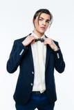 Stylish young man wearing elegant suit. Stock Images