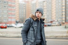 Stylish young man in a winter fashion jacket with a hat royalty free stock photography