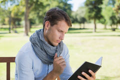 Stylish young man writing in his notepad Royalty Free Stock Photos