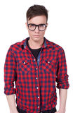 Stylish young men with glasses in the studio Stock Image