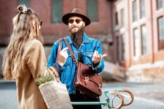 Stylish man and woman with retro bicycle outdoors stock photo