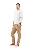 Stylish young modern man wearing ocher pants and red sneakers. Full body length portrait isolated over white studio background Stock Image