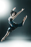Stylish and young modern style dancer is jumping. Stretched royalty free stock photos