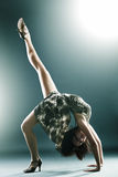 Stylish and young modern style dancer stretching Royalty Free Stock Photo