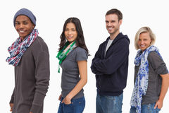 Stylish young people in a row smiling Royalty Free Stock Photo