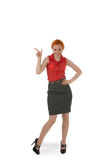 Stylish woman pointing to blank copyspace Royalty Free Stock Image
