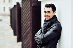 Stylish young smiling handsome man. Outdoor fashion portrait Stock Image