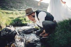 Stylish young wedding couple posing in beautiful Matterhorn moun Stock Photos