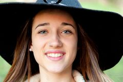 Stylish young woman with big hat Royalty Free Stock Photos