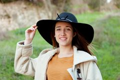 Stylish young woman with big hat Royalty Free Stock Photography
