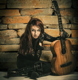 Woman in black with guitar Stock Photography