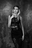 Stylish young woman in black lace top and skirt Stock Images