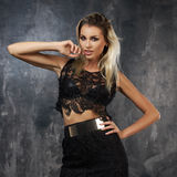 Stylish young woman in black lace top and skirt Stock Photos