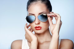 Stylish young woman in blue mirrored sunglasses stock photo