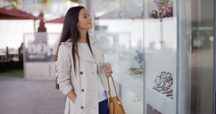 Stylish young woman browsing in a shopping mall Royalty Free Stock Image