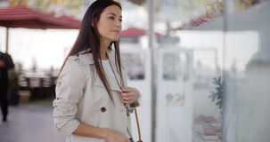 Stylish young woman browsing in a shopping mall Stock Photo