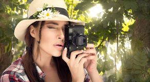 Stylish Young Woman Capturing Photos at the Forest Royalty Free Stock Image