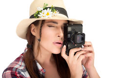 Stylish Young Woman Capturing Photos with Vintage Camera Royalty Free Stock Photo