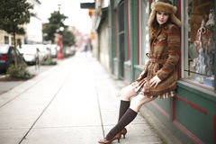 Stylish young woman in the city Stock Image
