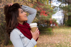 Stylish young woman with coffee outdoors during autumn Stock Photography