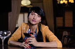 Stylish young woman drinking a glass of red wine Royalty Free Stock Photography