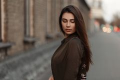 Stylish young woman in a fashion jacket in the street near. Road royalty free stock images
