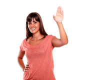 Stylish young woman greeting and looking you Royalty Free Stock Image