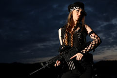 Stylish young woman with gun Royalty Free Stock Image