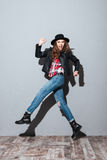 Stylish young woman in hat and leather jacket Royalty Free Stock Photos