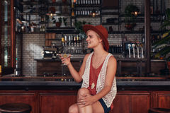 Stylish young woman having a drink at cafe Stock Images