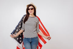 Stylish young woman holding American symbol in the studio royalty free stock image