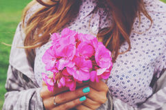 Stylish young woman holding bouquet of pink flowers Stock Photography