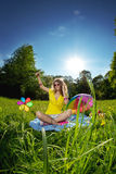 Stylish young woman listening to music in the park Royalty Free Stock Photos