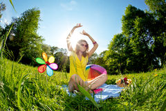 Stylish young woman listening to music in the park Royalty Free Stock Photo