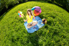 Stylish young woman listening to music in the park. Beautiful young woman listening to music in the park Royalty Free Stock Image