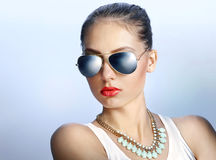 Stylish young woman in mirrored sunglasses Stock Image