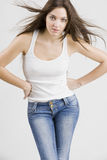Stylish young woman posing in clear background Royalty Free Stock Photography