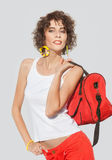Stylish young woman with red bag Stock Image