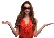 Stylish young woman in red dress and sunglasses. Close up shot of stylish young woman in red dress and sunglasses. Beautiful female model Stock Photos