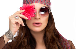 Stylish Young Woman with Red Flower Over her Eye Stock Photo