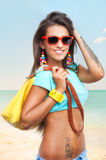 Stylish young woman on sea beach Stock Photography