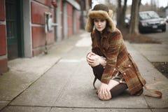 Stylish young woman on sidewalk Royalty Free Stock Image