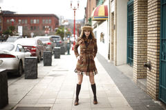 Stylish young woman on sidewalk Royalty Free Stock Photography