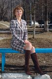 Stylish young woman sit on the bench. Royalty Free Stock Image