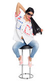 Stylish young woman sits on a chair. Girl twenty-six years. Stock Photos