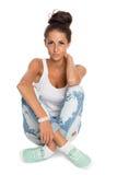 Stylish young woman sitting Royalty Free Stock Image