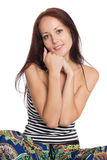 Stylish young woman sitting on the floor stock image
