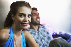Stylish Young Woman Smiling By A Man Royalty Free Stock Photos