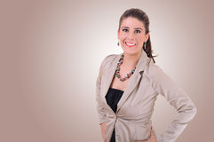 Stylish Young  Woman. Stylish Young Woman Smiling on a seamless background Royalty Free Stock Image